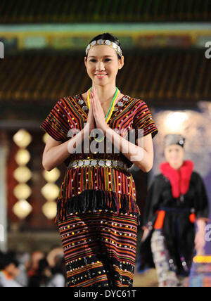 Hue. 13th Apr, 2014. A model presents Asian costume at the 'Oriental Night' show on the sidelines of the Hue Festival - Stock Photo