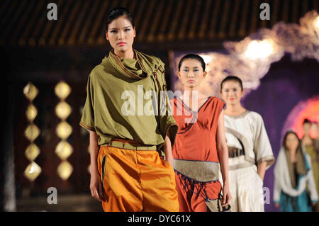Hue. 13th Apr, 2014. Models present Asian costumes at the 'Oriental Night' show on the sidelines of the Hue Festival - Stock Photo