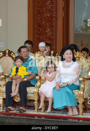 Phnom Penh, Cambodia. 14th Apr, 2014. Cambodian Prime Minister Hun Sen (L) and his wife Bun Rany (R) sit with their - Stock Photo