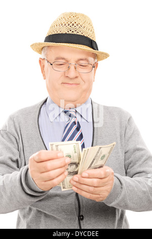 Senior gentleman counting money - Stock Photo