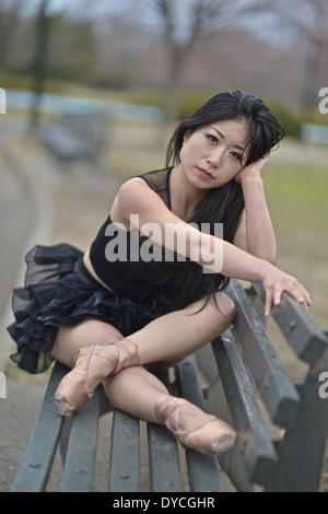 Asian ballerina wearing a black tutu - Stock Photo