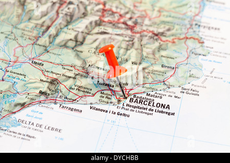 map pin pointing to barcelona on a road map stock photo royalty