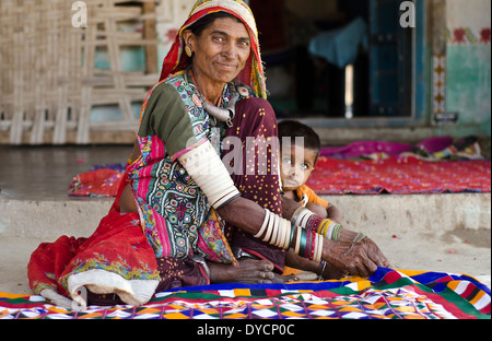 Harijan woman with her granddaughter  ,Jnan ,Kutch,India - Stock Photo