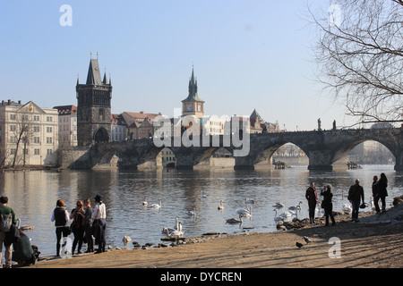 A view of Charles Bridge from the quay near the Kafka Museum - Stock Photo