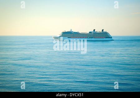 Luxury cruise liner at sunset in Mediterranean sea - Stock Photo