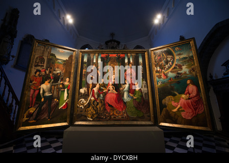 BRUGES, Belgium - Altar piece of John the Evangelist and John the Baptist. Hans Memling (c. 1430 - 1494) was commissioned - Stock Photo