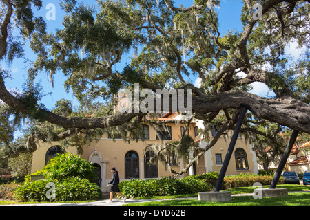 Winter Park Florida Rollins College campus school Rollins Hall live oak tree student branches supported - Stock Photo