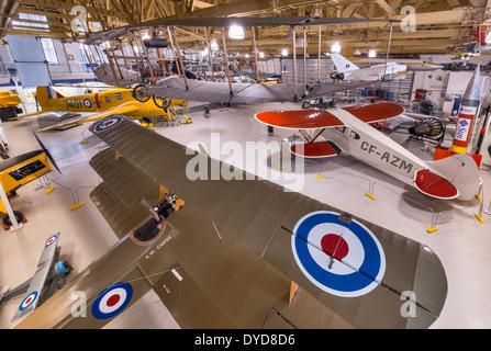 Sopwith Triplane, WW1 fighter replica in foreground at Main Hangar, Aero Space Museum, Calgary, Alberta, Canada - Stock Photo