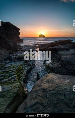 Rocky beach at Trebarwith Strand near Tintagel on the rugged north coast of Cornwall - Stock Photo