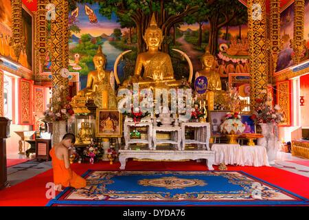 Monk, novice praying in front of a Buddha statue at Wat Sriboonruang, Sri Boon Ruang Temple, Chiang Rai, Northern - Stock Photo