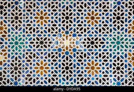 Mudéjar tiles with Moorish geometric patterns in the Alcázar of Seville, Seville province, Andalusia, Spain - Stock Photo