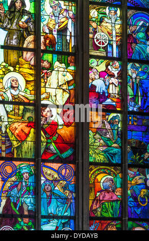 Part of the stained glass window by Alphonse Mucha in St Vitus Cathedral in Prague. - Stock Photo