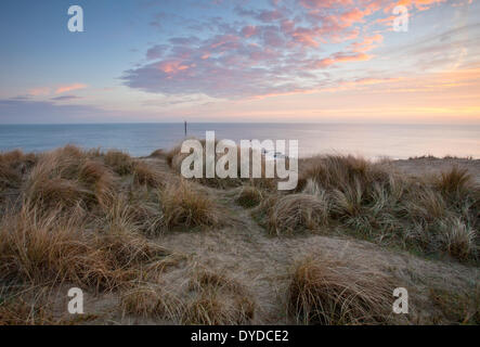 Sea Palling beach on a cold frosty morning on the Norfolk coast. Stock Photo