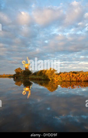 Stormy morning light over Turf Fen Mill on the Norfolk Broads. - Stock Photo
