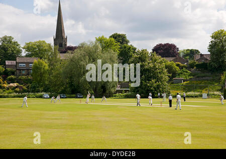 Men playing cricket at Masham. - Stock Photo