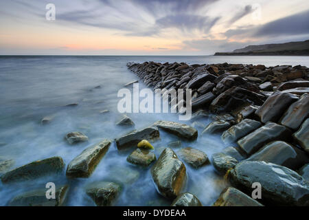 Sunset at Kimmeridge Bay in Dorset. - Stock Photo