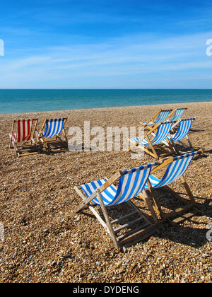 Deck chairs on Brighton beach. - Stock Photo