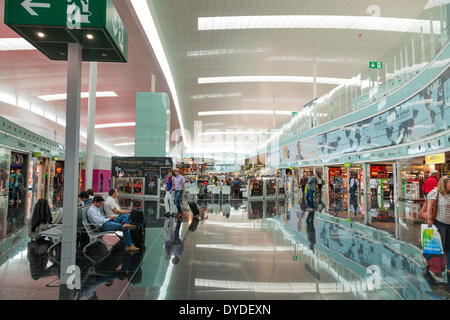 Shopping area in departure hall of Barcelona Airport. - Stock Photo