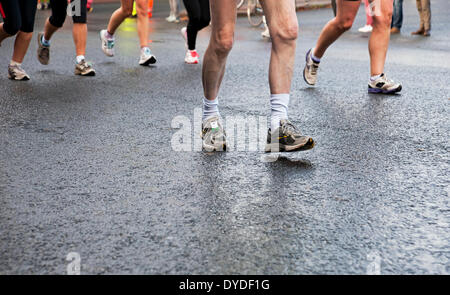 Detail of runners feet in a marathon. - Stock Photo