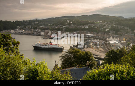 The Isle of Mull ferry leaving Oban early in the morning. - Stock Photo