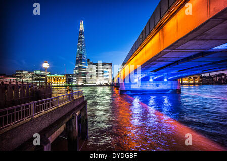 The Shard and London Bridge at dusk. - Stock Photo