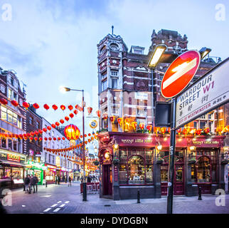 Wardour Street with decorations for the Chinese New Year. - Stock Photo