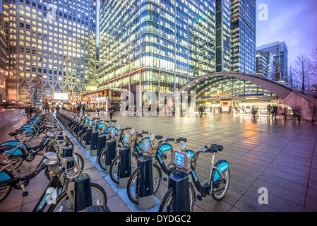 Canary Wharf tube station and Boris bikes. - Stock Photo