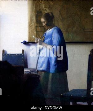Woman Reading a Letter by Johannes Vermeer (1632-1675). Oil on canvas c.1663-64. - Stock Photo