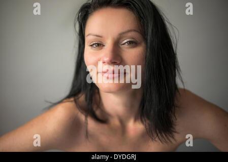 Beautiful woman with hazel eyes in the studio. - Stock Photo