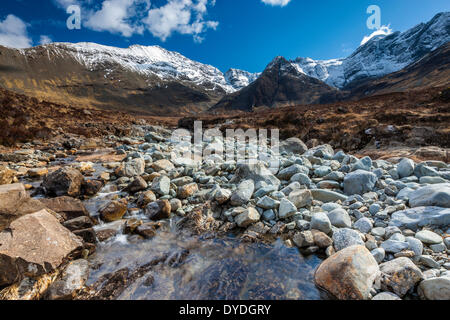The Cuillin Hills from beside the Allt Coir a Mhadhaidh on the Fairy Pools walk into Glen Brittle on the Isle of - Stock Photo