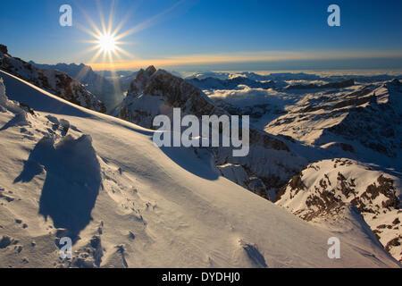 Evening Alps view Titlis mountain mountain panorama mountains Bernese Alps spring back light sky massif panorama - Stock Photo