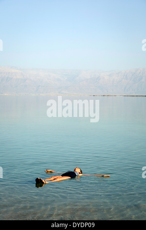 woman floating at the Dead Sea, Israel. - Stock Photo