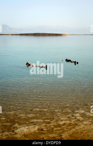People floating at the Dead Sea, Israel. - Stock Photo