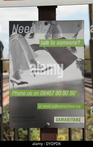 A Samaritans suicide prevention sign on the platform at Hanwell Station (main line), West London, UK. - Stock Photo