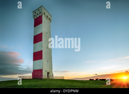 Sunset at the Gribbin Head lighthouse in Cornwall - Stock Photo