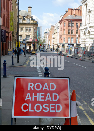 Road ahead closed traffic sign in King Street Manchester UK - Stock Photo