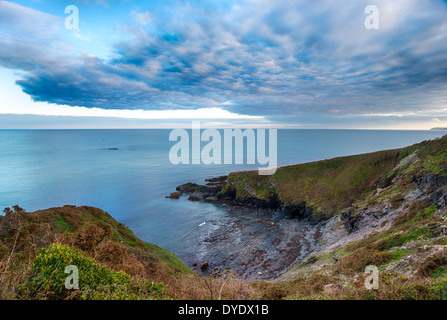Clouds gather over Gribbin Head near St Austell in Cornwall - Stock Photo