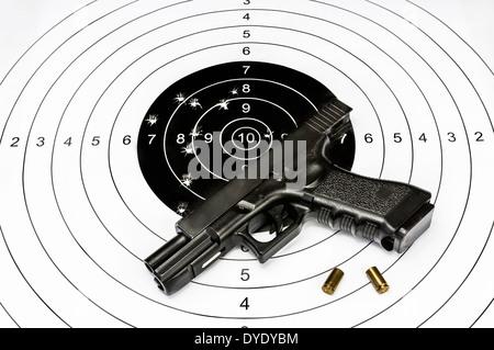 Gun and shooting target - Stock Photo