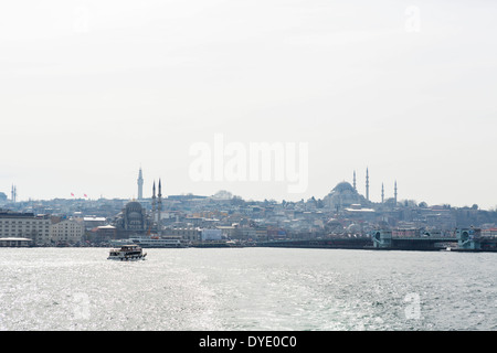 View of Sultanahmet and the Eminonu waterfront from the deck of a Sehir Hatlan Bosphorus Cruise, Istanbul, Turkey - Stock Photo