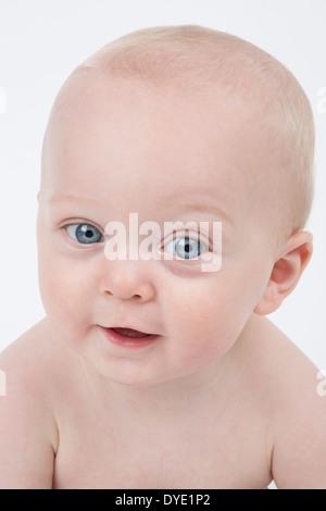 Cute Blue Eyed Baby, Smiling - Stock Photo