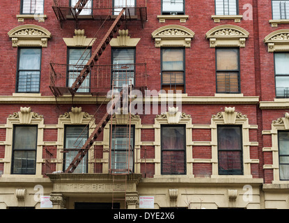 Detail of 'The Belle' apartment building, typical architecture with fire escapes on West 137th Street in Harlem, - Stock Photo