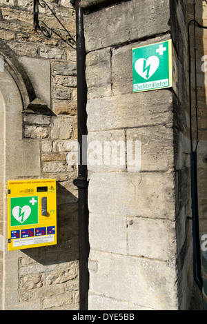 A public access defibrillator mounted to a wall in Malmesbury, Wiltshire, UK - Stock Photo