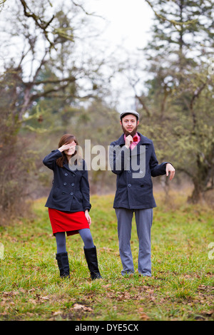Portrait of a happy couple engaged to be married in the winter outdoors. This couple is modern, trendy, hipster, - Stock Photo