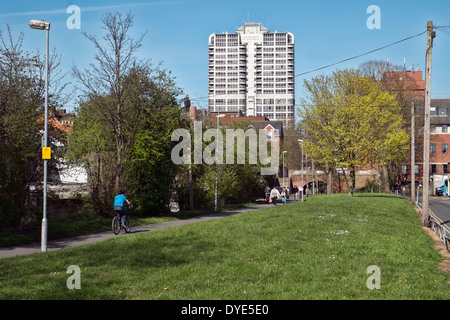A view of the David Murry John tower in Swindon town centre from the filled in Kennet & Avon canal with people on - Stock Photo