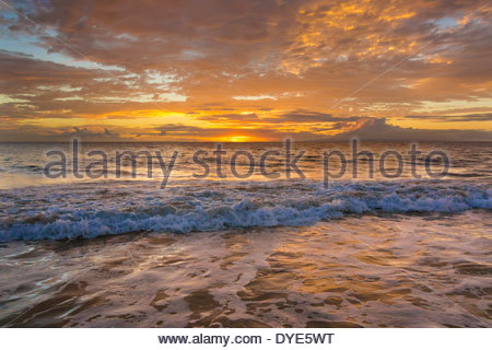 Pacific Ocean at sunset at Kamaole Beach at Kihei on the island of Maui in the state of Hawaii USA - Stock Photo