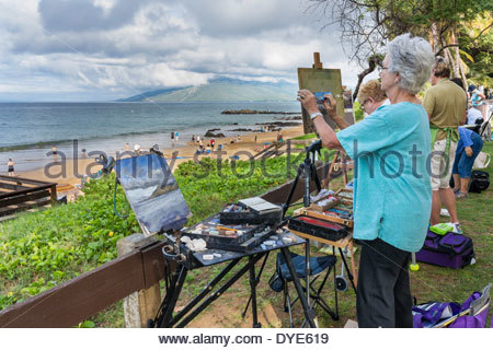 Artists group painting in En Plein Air at Kamaole Beach on the island of Maui in the state of Hawaii USA - Stock Photo