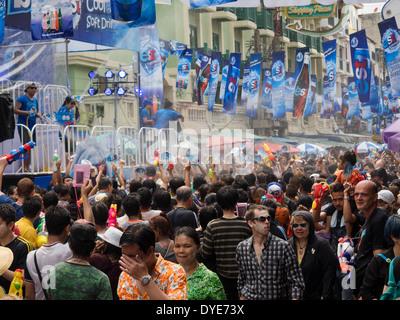Crowd celebrating Songkran, the traditional Thai New Year, on Khao San Road in Bangkok, Thailand. - Stock Photo
