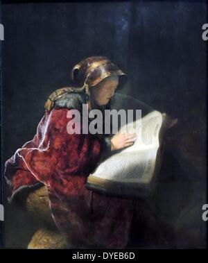 An Old Woman Reading, Probably the Prophetess Hannah by Rembrandt Harmens van Rijn (1606-1669) oil on panel, 1631. - Stock Photo