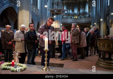 Family members and friends light candles during the funeral service for the killed student from Bulgaria in the - Stock Photo