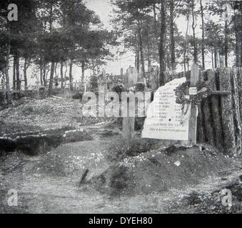 World War 1 - A German cemetery - in the foreground field of battle. Two fallen officers share a common epitaph. - Stock Photo